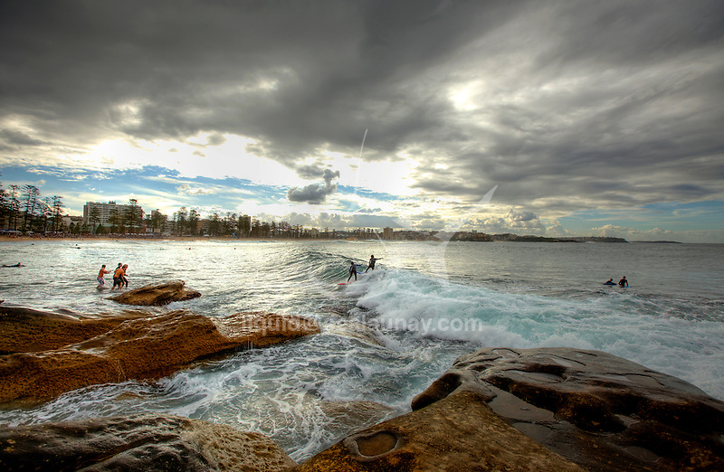Surf during a Sunrise at Manly Beach.