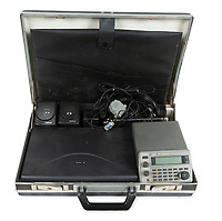 """BNPS.co.uk (01202 558833)<br /> Pic: Julien'sAuctions/BNPS<br /> <br /> Pictured: A Soviet KGB spy RS-1000 device for locating secret hidden microphone """"bugs."""" It includes a laptop, scanner, and software program on diskettes which help determine depth of hidden microphone.<br /> <br /> A selection of ingenious Cold War Soviet Union espionage items are set to sell for £75,000. ($100,000)<br /> <br /> They include a ring containing a hidden camera, valued at £9,000, and a 'spy tree' with a transmitter and recording equipment inside.<br /> <br /> The 64ins piece of shrubbery, estimated at a modest £600, would have been installed at locations to eavesdrop on their targets.<br /> <br /> A John Player cigarette case with a concealed camera could sell for £5,000, while a document copying device may go for £2,400."""