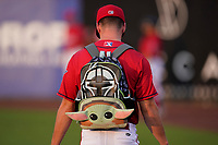 Pitcher Jake Wallace (20) of the Greenville Drive carries supplies to the bullpen in a Star Wars backpack before a game against the Greensboro Grasshoppers on Saturday, July 24, 2021, at Fluor Field at the West End in Greenville, South Carolina. (Tom Priddy/Four Seam Images)