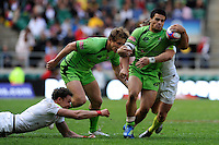 Allan Fa'alava'au of Australia is tackled during the iRB Marriott London Sevens at Twickenham on Sunday 13th May 2012 (Photo by Rob Munro)