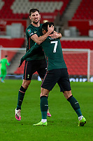 23rd December 2020; Bet365 Stadium, Stoke, Staffordshire, England; English Football League Cup Football, Carabao Cup, Stoke City versus Tottenham Hotspur; Ben Davies of Tottenham Hotspur celebrates his goal with Son Heung-min for 1-2 in the 70th minute