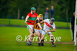 Crotta keeper Tom Cronin gathers an inbound sliotar as  Abbeydorney's  Aidan Leahy challanges him as Darragh Murnane comes to the aid of his keeper, in the County Hurling league Div 3 final