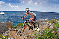 Jan Thiel, Curacao, Netherlands Antilles, April 2009. Mountainbiking is the perfect way to explore Curacao. Ellemieke van Beek of Wannabike tours guides a small group of bikers through the rugged nature of Jan Thiel Lagoon. Jan Thiel lagoon, located on the southeast side of the island, is a very popular area for local mountain bikers of all levels.<br /> The area is one of the most unique nature reserves on Curacao characterized by its rare vegetation, exceptional bird life, and unspoiled views. The island has a lot more to offer than sun, sea, and beaches! However, the best spots are hard to find without a guide, even with a map