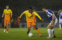 Jason Banton of Wycombe Wanderers takes on Lee Brown of Bristol Rovers as the rain falls during the Johnstone's Paint Trophy match between Bristol Rovers and Wycombe Wanderers at the Memorial Stadium, Bristol, England on 6 October 2015. Photo by Andy Rowland.