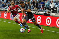 SAINT PAUL, MN - MAY 15: Hassani Dotson #31 of Minnesota United FC and Paxton Pomykal #19 of FC Dallas battle for the ball during a game between FC Dallas and Minnesota United FC at Allianz Field on May 15, 2021 in Saint Paul, Minnesota.