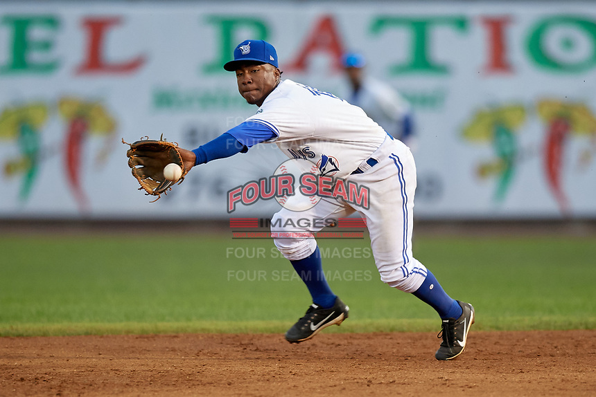 Bluefield Blue Jays second baseman Jose Theran (16) fields a ground ball during a game against the Bristol Pirates on July 26, 2018 at Bowen Field in Bluefield, Virginia.  Bristol defeated Bluefield 7-6.  (Mike Janes/Four Seam Images)