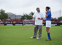 Duke head coach Robbie Church talks to Kim DeCesare before the game at Ludwig Field on the campus of the University of Maryland in College Park, MD. DC. Duke defeated Maryland, 2-1.