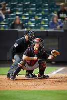 Chattanooga Lookouts catcher Dan Rohlfing (8) waits to receive a pitch waits to receive a pitch in front of home plate umpire Brock Ballou during a game against the Jackson Generals on April 27, 2017 at The Ballpark at Jackson in Jackson, Tennessee.  Chattanooga defeated Jackson 5-4.  (Mike Janes/Four Seam Images)