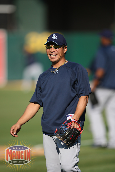 OAKLAND, CA - AUGUST 12:  Akinori Iwamura of the Tampa Bay Rays warms up before the game against the Oakland Athletics at the McAfee Coliseum in Oakland, California on August 12, 2008.  The Athletics defeated the Rays 2-1.  Photo by Brad Mangin