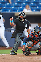 Umpire Brandin Sheeler strike call behind catcher David Rodriguez (7) during a game between the Bowing Green Hot Rods and Quad Cities River Bandits on July 24, 2016 at Modern Woodmen Park in Davenport, Iowa.  Quad Cities defeated Bowling Green 6-5.  (Mike Janes/Four Seam Images)