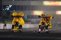 May 18, 2012; Topeka, KS, USA: NHRA top fuel dragster driver Steve Torrence (right) races alongside J.R. Todd during qualifying for the Summer Nationals at Heartland Park Topeka. Mandatory Credit: Mark J. Rebilas-