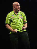 21.05.2015. London, England. Betway Premier League Darts Play-Offs.  Michael van Gerwen [NED] celebrates in his semi final game with Raymond van Barneveld [NED].  Michael van Gerwen [NED] won the match.