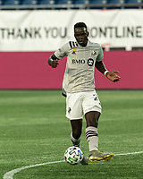FOXBOROUGH, MA - SEPTEMBER 23: Karifa Yao #24 of Montreal Impact passes the ball during a game between Montreal Impact and New England Revolution at Gillette Stadium on September 23, 2020 in Foxborough, Massachusetts.