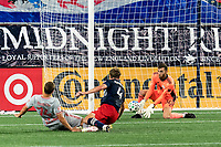 FOXBOROUGH, MA - AUGUST 29: Matt Turner #30 of New England Revolution makes a save on Tom Barlow #74 of New York Red Bulls shot during a game between New York Red Bulls and New England Revolution at Gillette Stadium on August 29, 2020 in Foxborough, Massachusetts.