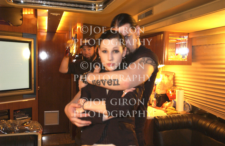 Guitarist Mick hangs with a friend on the tour bus after the show.