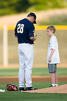 Jake Peavy #28 of the Charlotte Knights signs an autograph for a young fan prior to pitching in a rehab start against the Pawtucket Red Sox at Knights Stadium August 13, 2009 in Fort Mill, South Carolina. (Photo by Brian Westerholt / Four Seam Images)
