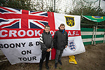 Holker Old Boys 2 Crook Town 1, 10/10/2020. Rakesmoor, FA Vase second round qualifying. Two visiting supporters in front of their club flag as Holker Old Boys take on Crook Town in an FA Vase second round qualifying tie at Rakesmoor, Barrow-in-Furness. The home club was established in 1936 as Holker Central Old Boys and was initially an under-16 team for former pupils of the Holker Central Secondary School. Holker from the North West Counties League beat their Northern League opponents 2-1, watched by a crowd of 147 spectators. Photo by Colin McPherson.