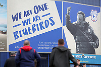 A general view of Cardiff City fans walking towards the Cardiff City Stadium which is decorated with a larger image of Cardiff City Manager Neil Warnock prior to kick off of the Sky Bet Championship match between Cardiff City and Birmingham City at The Cardiff City Stadium, Cardiff, Wales, UK. 11 March 2017