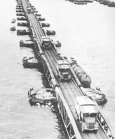 BNPS.co.uk (01202 558833)<br /> Pic: Pen&Sword/BNPS<br /> <br /> PICTURED: F.A.N.Y. BRCS ambulances crossing a Bailey bridge. There were 200 members in this unit.<br /> <br /> These inspiring photos of nurses on the front line feature in a new book which charts a century's heroic wartime service.<br /> <br /> The First Aid Nursing Yeomanry (FANY) was founded in 1907 by Captain Edward Baker with the early recruits trained in cavalry, signalling and camping.<br /> <br /> They were despatched to France at the outset for World War One to tend to injured troops on the battlefield, setting up hospitals for the many casualties. Other heroines dragged wounded personnel from exploding ammunition dumps.<br /> <br /> The brave nurses were again in the centre of the action in World War Two, performing sterling work in the harshest of conditions.<br /> <br /> Their stories feature in The First Aid Nursing Yeomanry in War and Peace, by Hugh Popham.