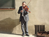 Street musician playing the violin