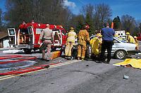 Rescue workers at simulated drunk-driving car collision with injuries