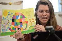 """Marie Parks, children's librarian at the West Fork Municipal Library, reads the book, """"Elmer the Patchwork Elephant,"""" by David McKee Tuesday, Feb. 23, 2021, for young patrons over the internet inside the library. Parks reads and sings to students at 10:30 each Tuesday morning with a particular lesson or theme each week before helping viewers with a craft. Visit nwaonline.com/210224Daily/ for today's photo gallery. <br /> (NWA Democrat-Gazette/Andy Shupe)"""