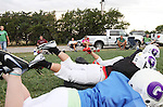 CHAD PILSTER •Hays Daily News<br /> <br /> Parents watch as their kids do a drill that involves diving on a pad on Tuesday, September 10, 2013, during practice of the third grade Gamblers of the Hays Football Association  at Aubel-Bickle Park in Hays, Kansas.