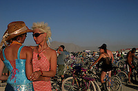 A lesbian couple  dance in Burning Man festival, Nevada, USA, September 2, 2005..Born in Argentina, photographer Ivan Pisarenko in 2005  decided to ride his motorcycle across the American continent. While traveling Ivan is gathering an exceptional photographic document on the more diverse corners of the region. Archivolatino will publish several stories by this talented young photographer..Closer look at  Ivan's page www.americaendosruedas.com....