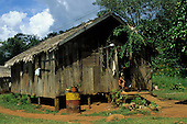 Santa Clara, Brazil. Rough wooden and thatch Caboclo house with oil drum; Amazon, Amapa State.