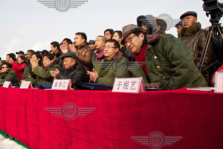 Judges watch the storyteller's performances at the Ma Jie folk festival. <br /> <br /> For centuries farmers in Henan have gathered during Chinese New Year in the region's wheat fields to listen to bards singing and recounting old tales. <br /> <br /> Now storytellers come from all over China to attend the annual festival where large crowds gather to watch the best performers.