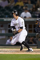 Brandon Guyer (11) of the Charlotte Knights follows through on his swing against the Toledo Mud Hens at BB&T BallPark on April 25, 2019 in Charlotte, North Carolina. The Mud Hens defeated the Knights 11-7. (Brian Westerholt/Four Seam Images)