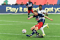 FOXBOROUGH, MA - APRIL 24: Henry Kessler #4 of New England Revolution passes the ball as Nigel Robertha #19 of D.C. United  defends during a game between D.C. United and New England Revolution at Gillette Stadium on April 24, 2021 in Foxborough, Massachusetts.