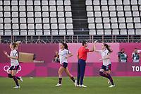 KASHIMA, JAPAN - AUGUST 4: Head Coach Vlatko Andonovski of the United States greets Tierna Davidson #12 of the United States before a game between Australia and USWNT at Kashima Soccer Stadium on August 4, 2021 in Kashima, Japan.