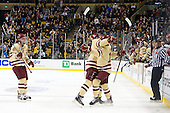 Edwin Shea (BC - 8), Chris Kreider (BC - 19) and Pat Mullane (BC - 11) celebrate Mullane's goal which opened scoring in the game. - The Boston College Eagles defeated the Boston University Terriers 3-2 (OT) to win the 2012 Beanpot championship on Monday, February 13, 2012, at TD Garden in Boston, Massachusetts.