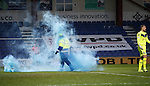 Ross County v St Johnstone...05.12.15  SPFL  Dingwall<br /> A smoke bomb is thrown near Gary Woods after he conceded the first goal<br /> Picture by Graeme Hart.<br /> Copyright Perthshire Picture Agency<br /> Tel: 01738 623350  Mobile: 07990 594431