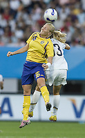 USA forward (13) Kristine Lilly and Sweden defender (16) Anna Paulson. The USA defeated Sweden 2-0 during their Group B first round game at the 2007 FIFA Women's World Cup at Chengdu Sports Center Stadium in Chengdu, China on September 14, 2007.