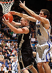 SIOUX FALLS, SD - MARCH 17: Dakota Valley's Evan Steemken pulls in a rebound in front of St. Thomas More's Jeremy Henderson in the first half of the 2012 Class A Boys Basketball Championship Saturday night at the Sioux Falls Arena.  (Photo by Dave Eggen/Inertia)