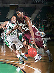 University of Louisiana at Monroe Warhawks guard Fred Brown (55) and North Texas Mean Green guard Josh White (10) in action during the NCAA  basketball game between the University of Louisiana at Monroe Warhawks and the University of North Texas Mean Green at the North Texas Coliseum,the Super Pit, in Denton, Texas. ULM defeated UNT 82 to 75...