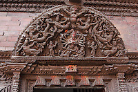 Kathmandu, Nepal.  Carved Panel above the Entrance into the Living Quarters of the Kumari Devi in the Kumari Bahal, House of the Kumari Devi, a Young Girl Revered as a Living Goddess.  The woodwork is carved from sal wood, shorea robusta, and was carved in the mid-eighteenth century.