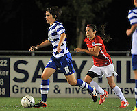 20130906 - OOSTAKKER , BELGIUM : Gent's Evelien van Sinay (left) pictured with PSV's Danielle Van De Donk (right) during the female soccer match between AA Gent Ladies  and PSV / FC Eindhoven Dames , of the third matchday in the BENELEAGUE competition. Friday 06 th September 2013. PHOTO DAVID CATRY