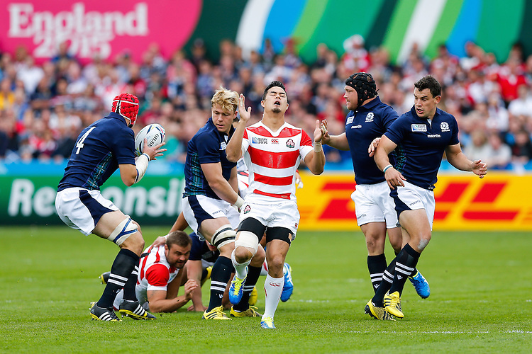 Japan Inside Centre Yu Tamura looks frustrated after dropping the ball - Mandatory byline: Rogan Thomson - 23/09/2015 - RUGBY UNION - Kingsholm Stadium - Gloucester, England - Scotland v Japan - Rugby World Cup 2015 Pool B.