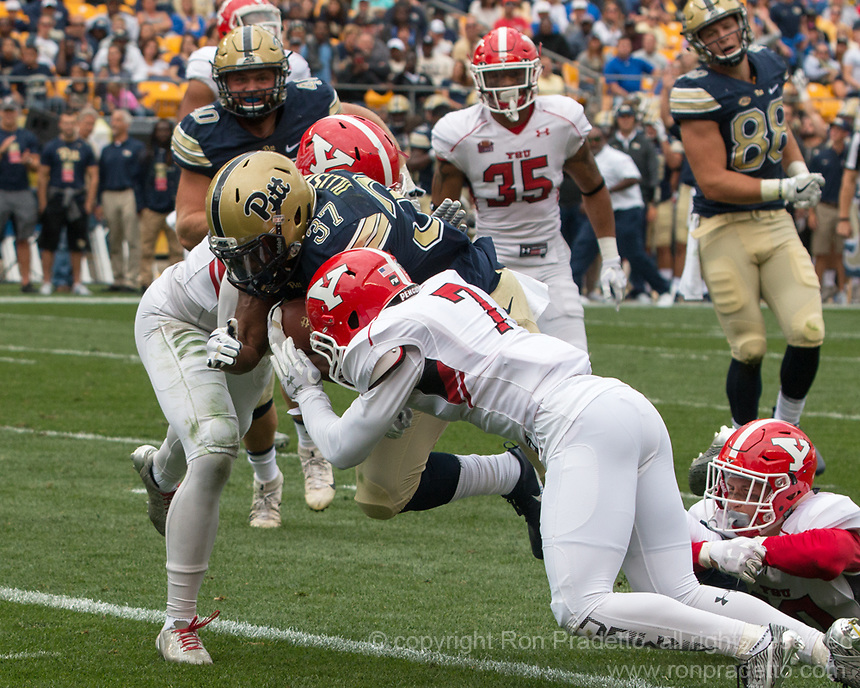 Pitt running back Qadree Ollison (37) scores on a 5-yard touchdown run. The Pitt Panthers defeated the Youngstown State Penguins 28-21 in overtime at Heinz Field, Pittsburgh, Pennsylvania on September 02, 2017.