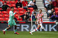 11th September 2021;  Bet365 Stadium, Stoke, Staffordshire, England; EFL Championship football, Stoke City versus Huddersfield Town; Jacob Brown of Stoke City clears the ball under pressure from  the pitch