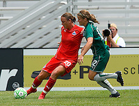Washington Freedom forward Abby Wambach (20)  passes the ball as St. Louis Athletica Elise Weber (12) defends during a WPS match at Anheuser-Busch Soccer Park, in Fenton, MO, June 20 2009. Washington  won the match 1-0.