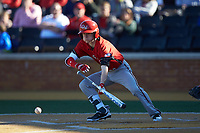 Taber Mongero (23) of the Gardner-Webb Runnin' Bulldogs lays down a bunt against the Wake Forest Demon Deacons at David F. Couch Ballpark on February 18, 2018 in  Winston-Salem, North Carolina. The Demon Deacons defeated the Runnin' Bulldogs 8-4 in game one of a double-header.  (Brian Westerholt/Four Seam Images)