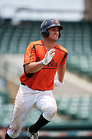 GCL Orioles first baseman J.C. Escarra (10) runs to first base during a game against the GCL Rays on July 21, 2017 at Ed Smith Stadium in Sarasota, Florida.  GCL Orioles defeated the GCL Rays 9-0.  (Mike Janes/Four Seam Images)