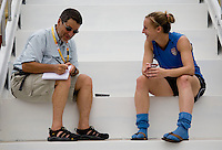 USWNT forward Amy Rodriguez talks to Chicago Tribune reporter Philip Hersch after practice. The USWNT practiced at Beijing Normal University in Beijing, China.  The team will now move to Qinhuangdao to prepare for their first two group games of the 2008 Olympics.