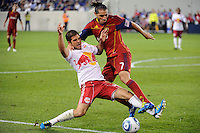 Carlos Mendes (44) of the New York Red Bulls and Fabian Espindola (7) of Real Salt Lake battle for the ball. Real Salt Lake defeated the New York Red Bulls 3-1 during a Major League Soccer (MLS) match at Red Bull Arena in Harrison, NJ, on September 21, 2011.