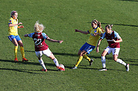 Grace Fisk of West Ham clears from Aileen Whelan of Brighton during West Ham United Women vs Brighton & Hove Albion Women, Barclays FA Women's Super League Football at the Chigwell Construction Stadium on 15th November 2020