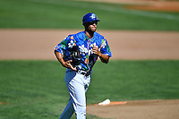 Ogden Raptors coach Pedro Guerrero (40) trots off the field between innings against the Helena Brewers in Pioneer League action at Lindquist Field on July 16, 2016 in Ogden, Utah. Ogden defeated Helena 5-4.  (Stephen Smith/Four Seam Images)
